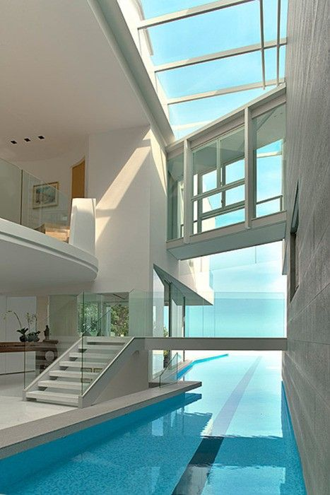 Indoor/outdoor lap pool. Image: sunsurfer.tumblr.com .... Goes through the house. Like the house design also.