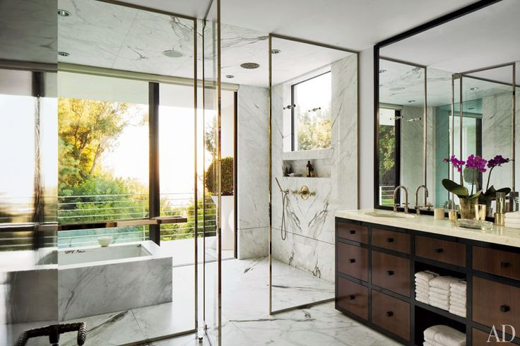 Master bath sheathed in Calacatta marble Design by Waldo Fernandez. From Architectural Digest.