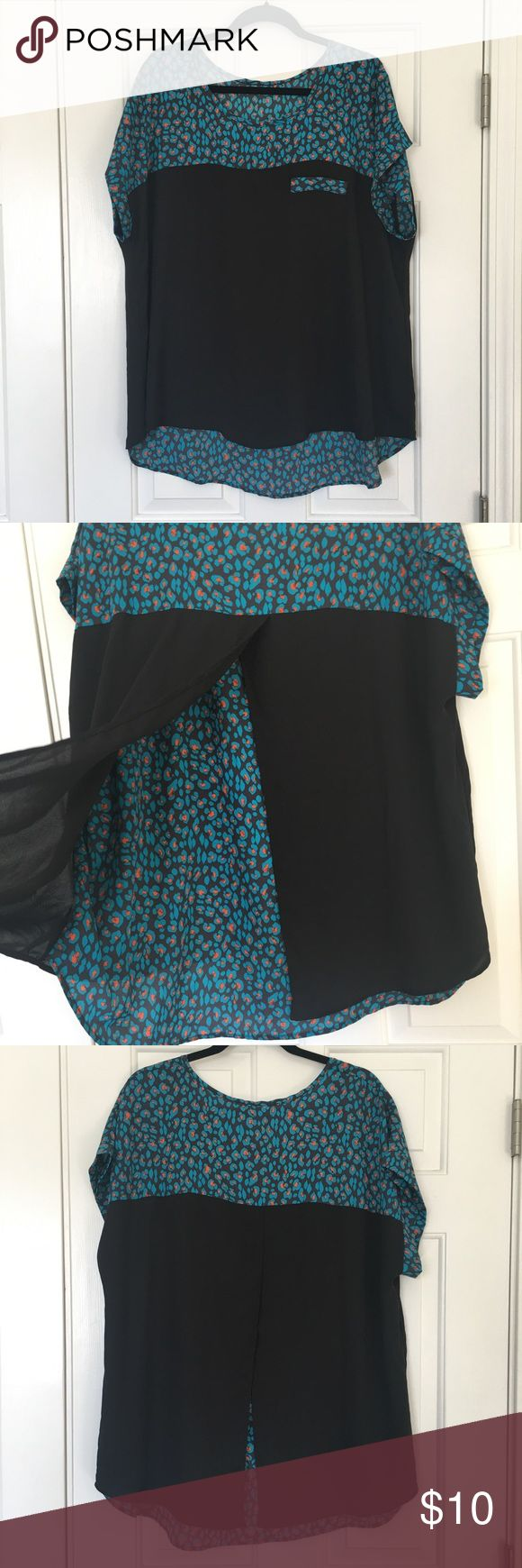"""Black split back short sleeve top Black teal and orange short sleeve Chiffon top  The brand tag has been removed, material content tag is still attached. Made of 100% polyester with hand wash instructions on the care tag  Length of top is about 28"""" in the front and 31"""" in the back bust is about 52"""" No stretch to the fabric. Back is cut away split style with the pattern material showing. Smoke free home none Tops Blouses"""