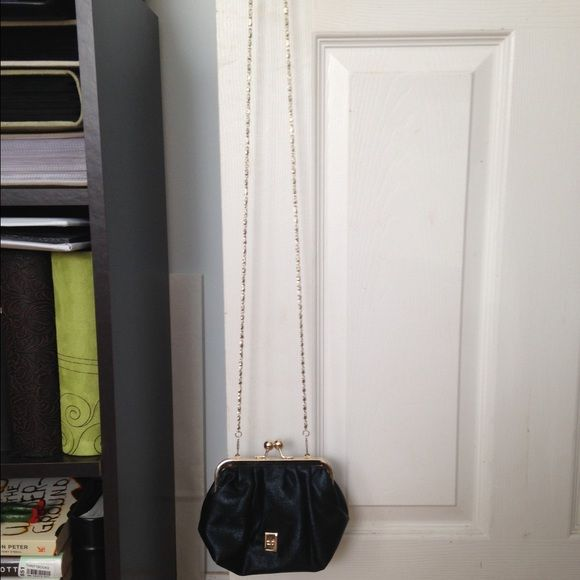 Thursday Friday small clutch/shoulder bag Black and gold Thursday Friday bag. Has a detachable long gold and black chain. Can be worn as a shoulder bag or used as a small clutch. The chain fits right inside the bag to be stored away. Used once for a few hours at my rehearsal dinner. Great condition. Bag as a little sparkle to it in the light. Thursday/Friday Bags