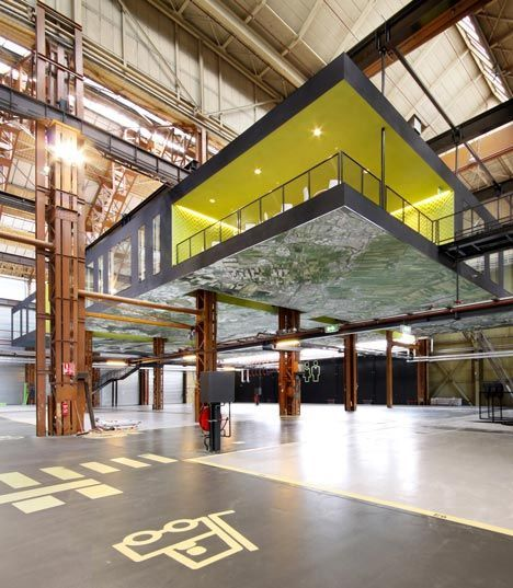Rotterdam, Netherlands... Dutch architecture firm Groosman Partners has suspended an office complex beneath the eight-metre-high ceiling of a former industrial machine hall in Rotterdam (+ slideshow).