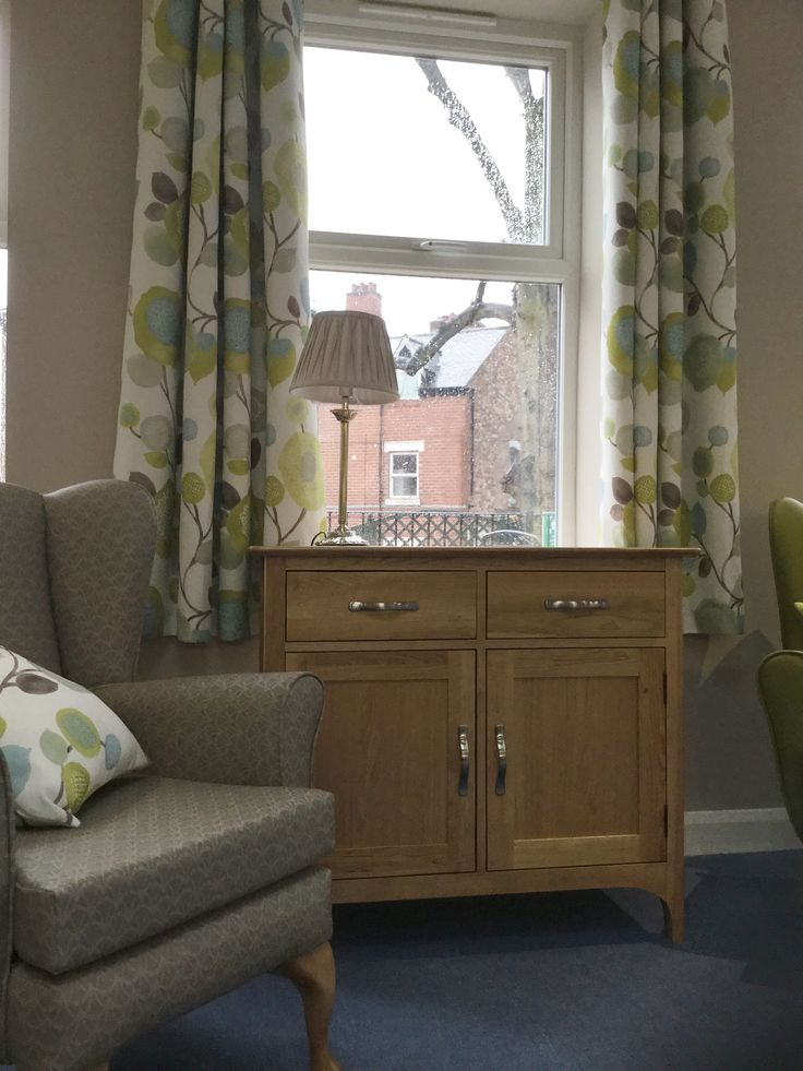 Panaz celeste curtains waterproof wing chairs and solid oak sideboards at Seely Hirst care Home