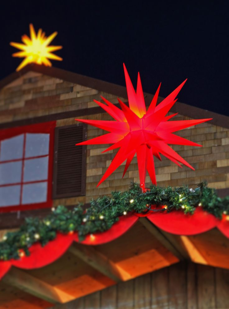Traditional and lovely Christmas decorations in red and yellow. See how the Herrnhut Stars brightened the Vancouver Christmas Market 2015. #mybrilliantstar #herrnhutstar #moravianstar #christmas #decoration #vancouverchristmasmarket