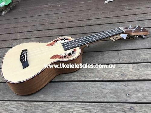 Concert Spruce Top ukulele, Laser Engraved Leaf Inlay with turtle shell top binding and side binding.