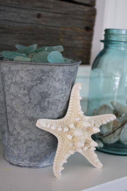 aqua mason jar, sea shells, star fish, tin bucket filled with sea glass