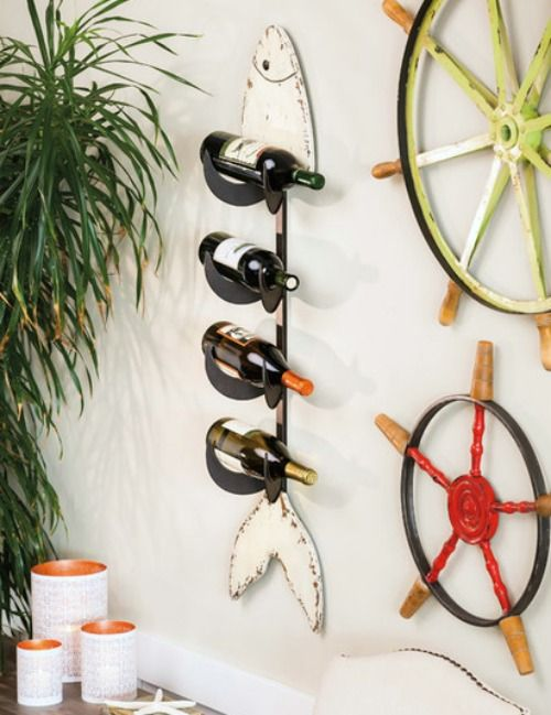 Coastal Wine Bottle Racks: http://www.completely-coastal.com/2016/03/wine-bottle-racks-coastal-nautical.html Store your Wine in Style! From a Clever Boat Rack to an Unexpected Seashell Design to a Fish Wall Wine Rack, and beyond.