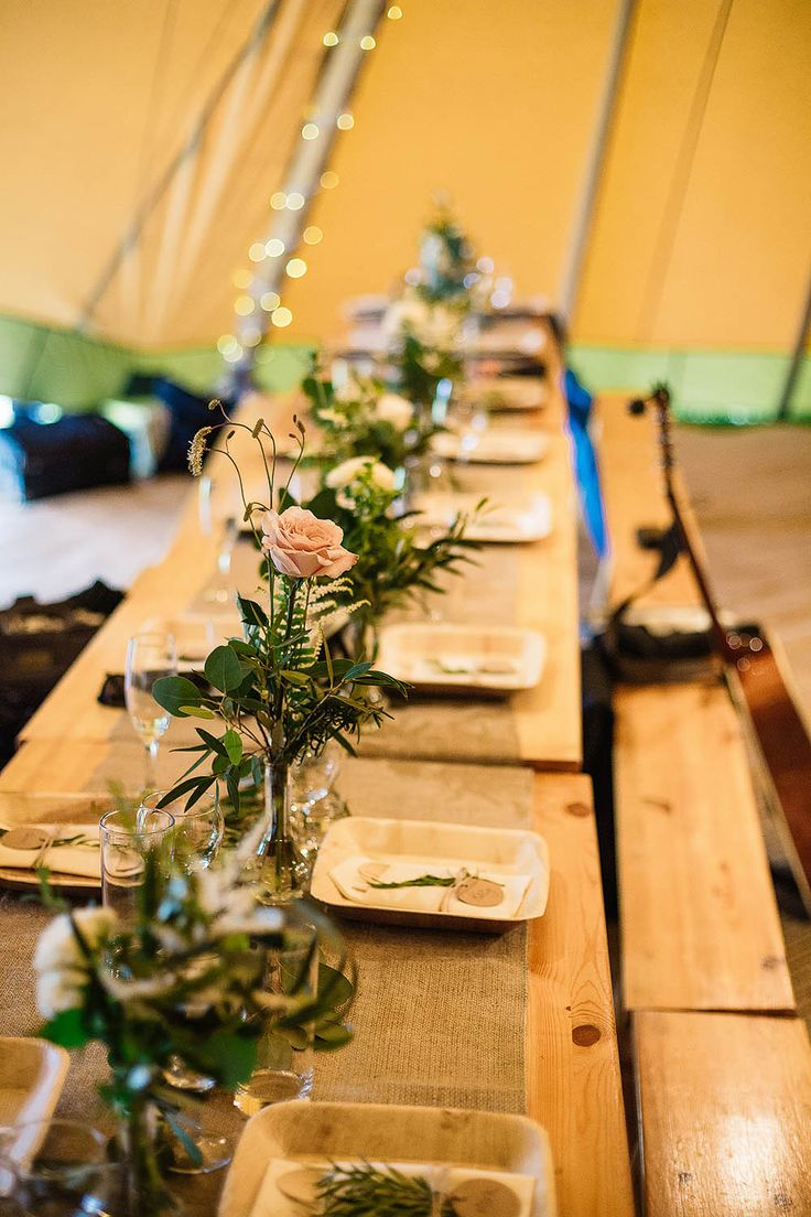 Wooden Trestle Tables | Rustic Wedding Decor - Paul Joseph Photography | Botanical Outdoor Ceremony at Hill Top Farm in Cheshire with a Tipi Wedding Reception.