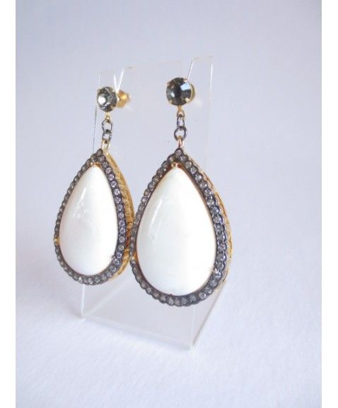 IVORY TEARDROP EARRINGS  White teardrops encrusted in Swarovski Crystals for a subtle earring, this style is surprisingly light on the ear Designed in WA  Earring post is hypo-allergenic  Materials include plated brass, hypo-allergenic metal, Acrylic, Swarovski Crystal