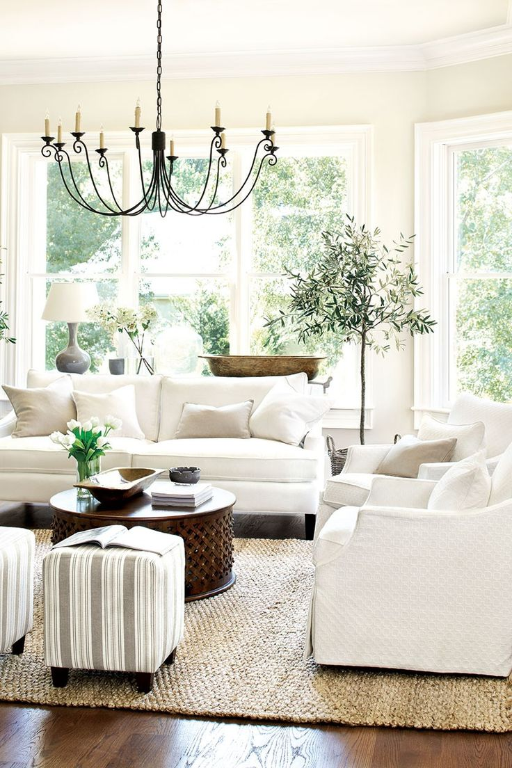 Living Room Decor Ideas   White Traditional Cottage Style, White  Slipcovered Sofas, Rustic Metal Chandelier, Striped Ottomans, Round  Metallic Coffee Table ...