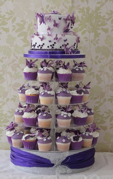 Purple and white butterfly wedding cake. Could do something other than butterflies, like cupcakes with small cake