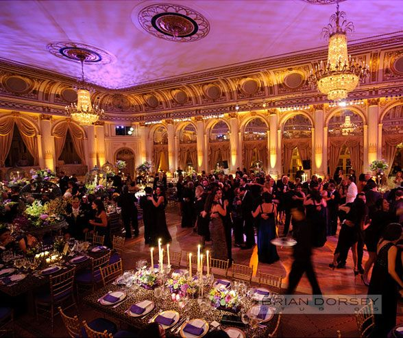 Plaza Hotel NYC Wedding | Guests dressed in ball gowns and black tuxedos flood the dance floor for this formal wedding reception.