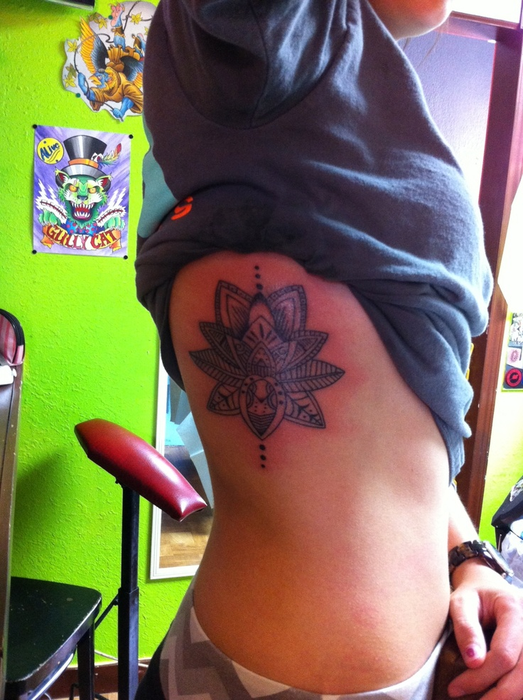 lotus flower rib tattoo Damnit that's what I wanted! Doesn't look as good here