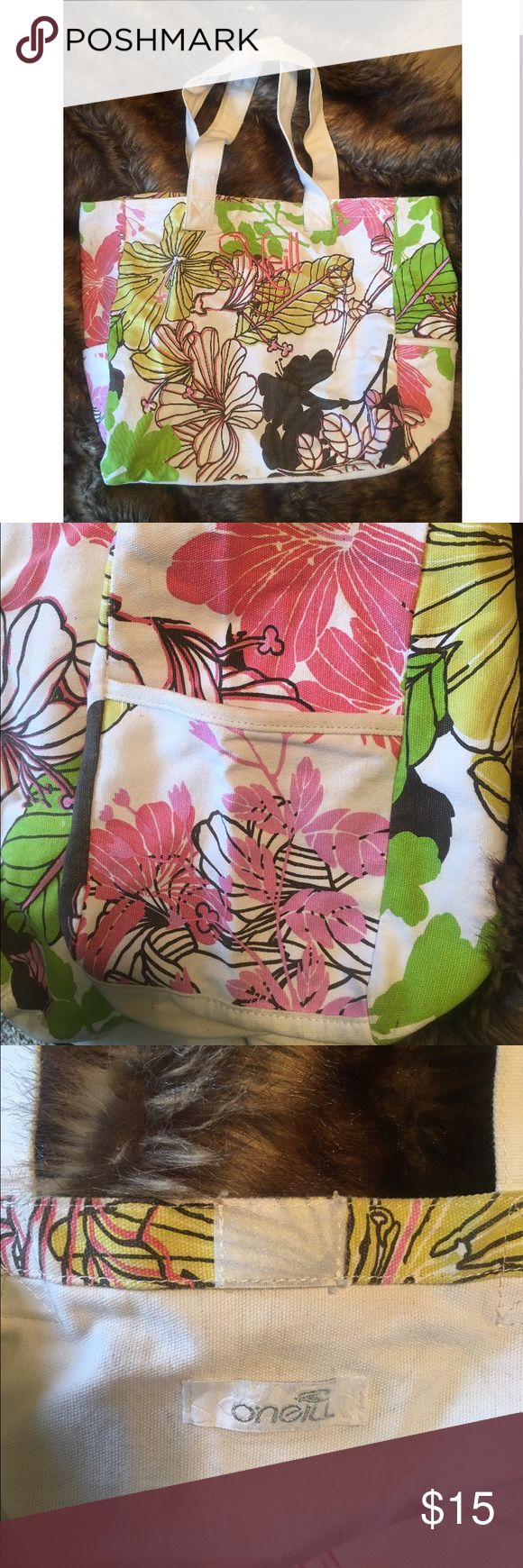 O'Neill Floral Tote Bag Adorable Floral Tote Bag, Velcro Closure, Pockets on Each Side, 21 inches wide & 14 inches tall (Laying Flat). Perfect Daily Tote! Lightly Used As A Beach Bag & For School But in Good Shape! O'Neill Bags Totes