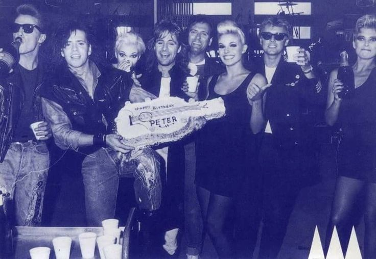Roger Taylor with 'The Cross' and Debbie Leng at Peter Noone's birthday party in September 9 1987.