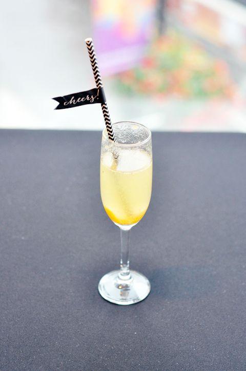 Peach nectar cocktail with cute straw & flag detail