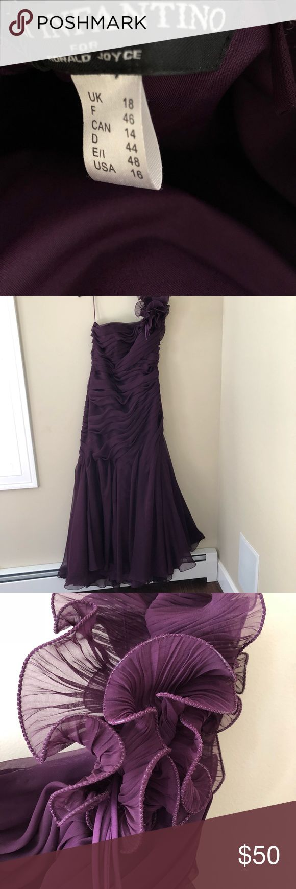 Beautiful NWT Aubergine Gown Size 16 This dress has never been worn and is new with tags.  It is strapless with a ruffled shoulder strap (a little loose and meant to hang down around the upper arm).  The rushing and buttons done the back coupled with the slight train make this a perfect Prom or Black Tie affair dress.  The color is absolutely stunning.  Back Zip (hidden by buttons).  Fabric has little to no give and there is pliable boning in the bodice Veni Infantino Dresses Strapless