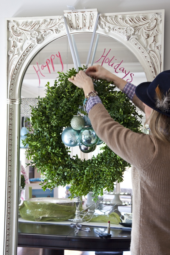 simple wreath with ornaments in front of a mirror