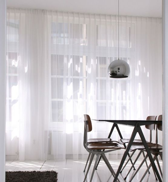 """Elegant All White Homes  To """"increase the feeling of space"""" in his Amsterdam apartment, architect and designer James Webb of Gabriëls Webb chose to whitewash all the surfaces, a vision that included painting the wood floor in a high-gloss white. The end result is both cool and bright."""