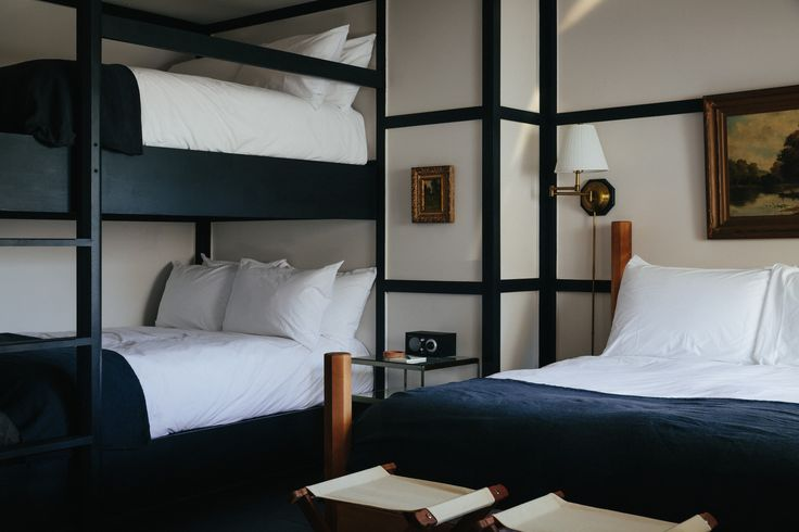 The beds are topped off with custom hand-dyed French linen blankets from Brooklyn-based Sharktooth. Additionally, each room is finished with high-gloss painted plywood floors that have a decorative wood trim running the edge of the room.