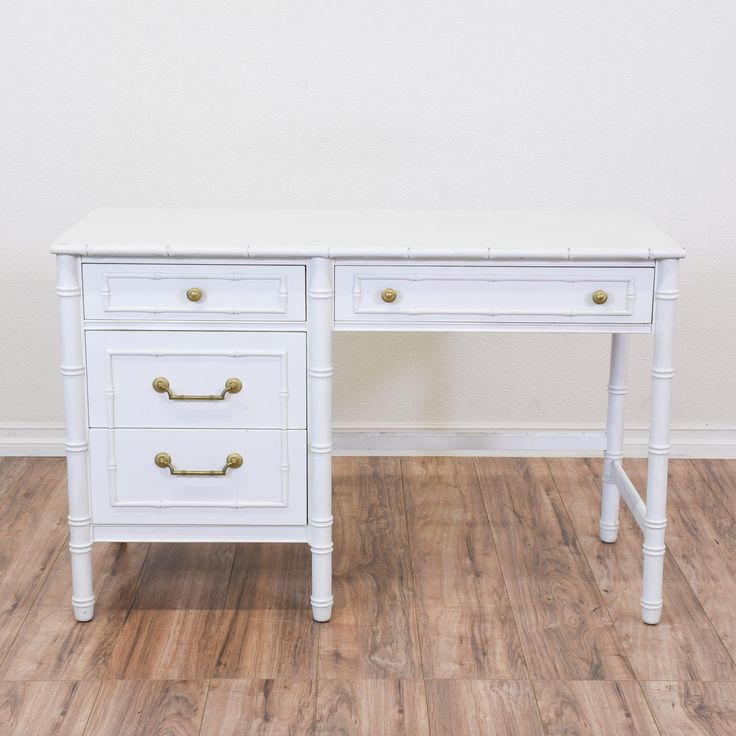 """This """"Thomasville"""" desk is featured in a solid wood with a fresh white paint finish. This tropical desk is in great condition with 4 large drawers, faux carved bamboo details and shiny gold hardware. Beach chic desk perfect for a laptop storage! #tropical #desks #kneeholedesk #sandiegovintage #vintagefurniture"""
