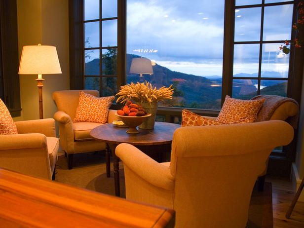 Love this idea... four cozy upholstered armchairs right off kitchen.. from HGTV Dream Home 2006.