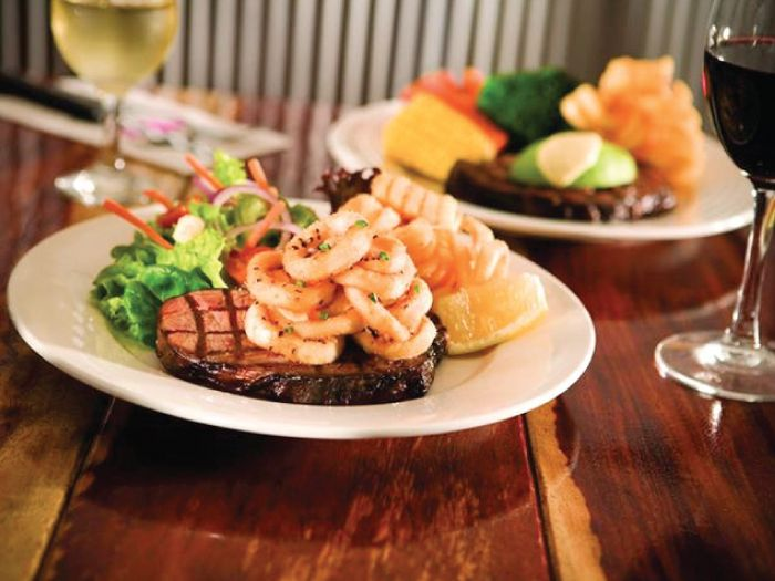 """The Best Steaks In Town! Hog's Breath Cafe is """"the home of Hog'spitality!"""" Specialising in 18 hr slow cooked Prime Rib Steaks. The best a steak can get! Providing quality food & beverage in a casual environment with a friendly, party atmosphere. Nelson Bay, Port Stephens."""