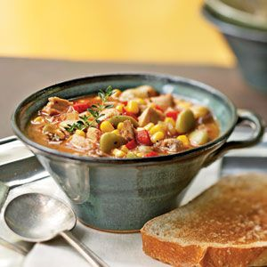 Brunswick stew   is a classic Southern dish featuring meat, chopped bell pepper, lima beans, and corn in a tomato base. Developed in 19th-century Virginia, this stew originally included squirrel meat (we opt here for chicken). This version uses flour to give the stew body and features garlic bread on the side. Garnish with fresh thyme sprigs.