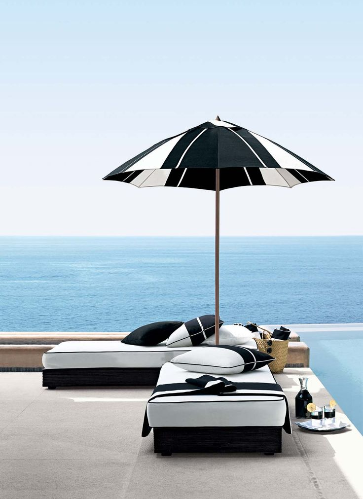 Crisp black and white fabric creates a chic seaside outdoor lounge, from Ralph Lauren Home