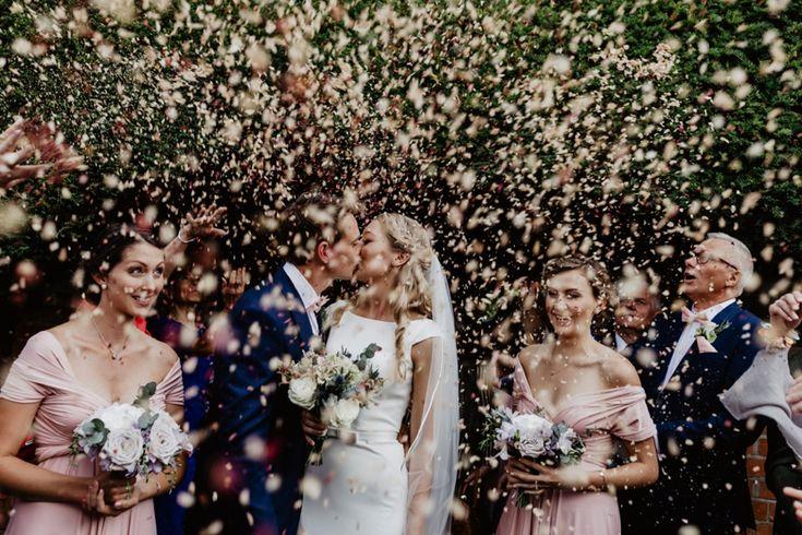 Confetti shower!!! Photo by Benjamin Stuart Photography #weddingphotography #confetti #kiss #justmarried #brideandgroom #groupshot