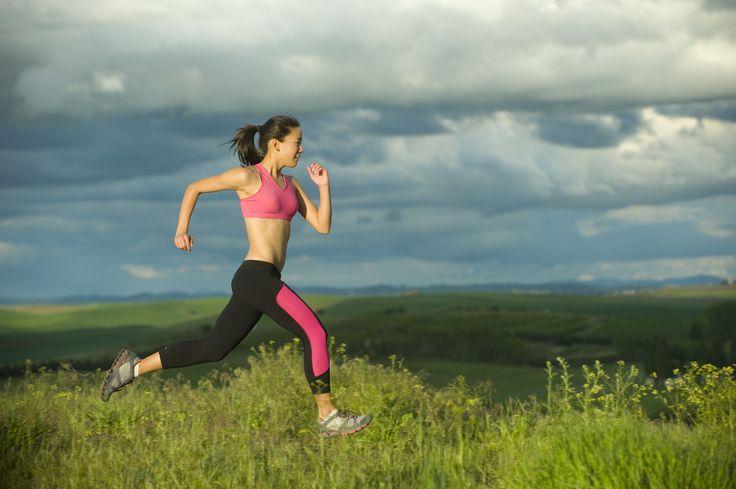 Japanese woman running in field - Japanese woman running in field
