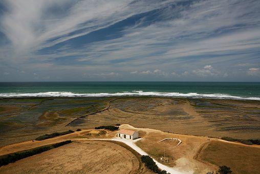 Landscape, Atlantic coast near the Phare de Chassiron lighthouse at low tide, Ile d'Oleron island, Poitou-Charentes region, departement of Charente-Maritime, France, Europe