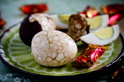 Chinese Tea Egg Recipe.  Tea eggs: Hard boil eggs.  Crack them in the shells all over.  Put back in pot with black tea, sugar, salt.  Bring to a boil, then let simmer until flavored to taste