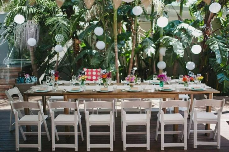 Outdoor tablescape, table setting, flowers in jars, black and white photos. Pavilion 2, Byron Bay NSW