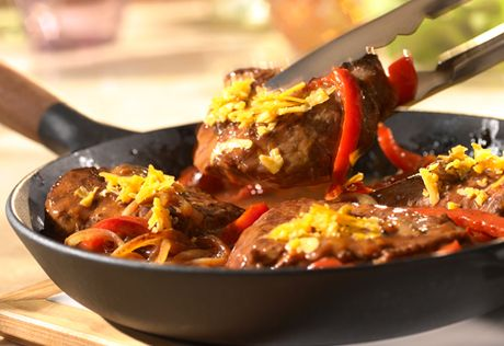 It's like fajitas without the tortillas! This simple, pan-seared steak getsgreat flavor from asavory sauce...but best of all, it's topped with cheese. Steak just doesn't get any better!