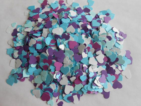 This listing is for just over 2000 die-cut MINI hearts, measuring from 1/8 to 1/4. They are made from nice cardstocks. There are over 2000 hearts