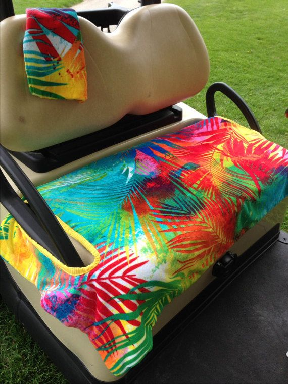 Rainbow Palm Golf Cart Seat Cover with matching towel is made from 2 layers of terry cloth. Handle openings in complimentary fabric provide ease of installation. Nothing to fasten nor tie. Heaviness of the 2 layers keeps the seat cover from blowing off the cart on windy days. The underneath layer is a solid teal. Totally reversible. No more sticking to hot nasty golf cart seats. Keeps you warm on cool, damp days The matching golf towel comes with a loop to put on your bag. Machine wash and…