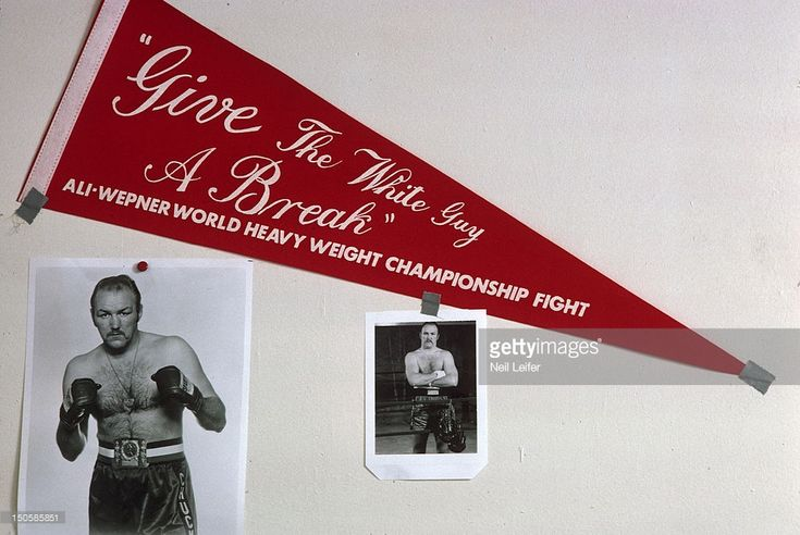 News Photo : View of photos and pennant of Chuck Wepner at his...