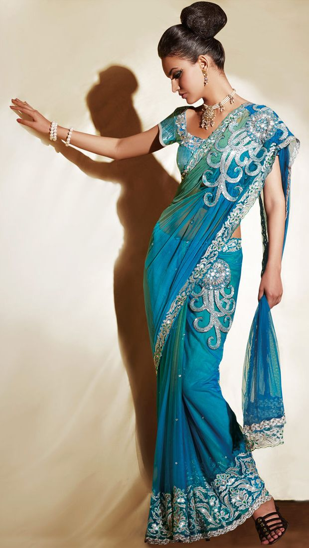 beautiful net saree is in light blue and green combination, embellished with embroidered stone work in dots motif design all over, with embroidered zari, sequence and cutdana work $244.95