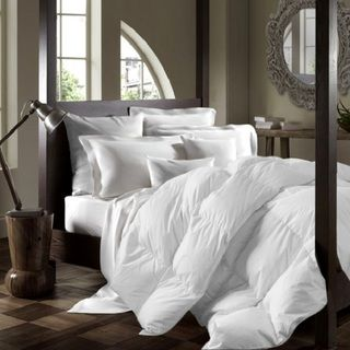 Drift to sleep in plush comfort and warmth with this premium white duck down duvet comforter, suitable for chilly nights.: