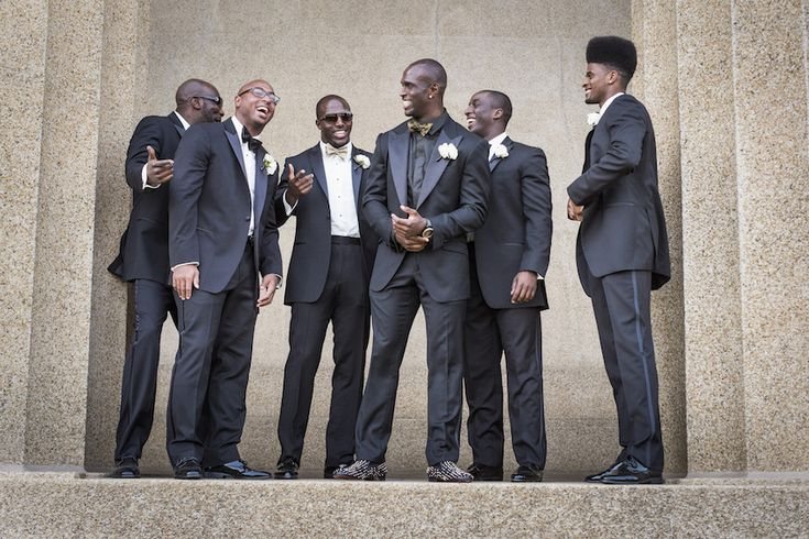 While NFL Tennessee Titans player Jason McCourty's groomsmen donned black tuxedos and bow ties, his best man and twin brother, Devin McCourty of the New England Patriots, wore a golden bow tie. #groomsmen Photography: McLellan Style. Read More: http://www.insideweddings.com/weddings/nfl-tennessee-titans-players-gold-white-wedding-in-nashville-tn/652/