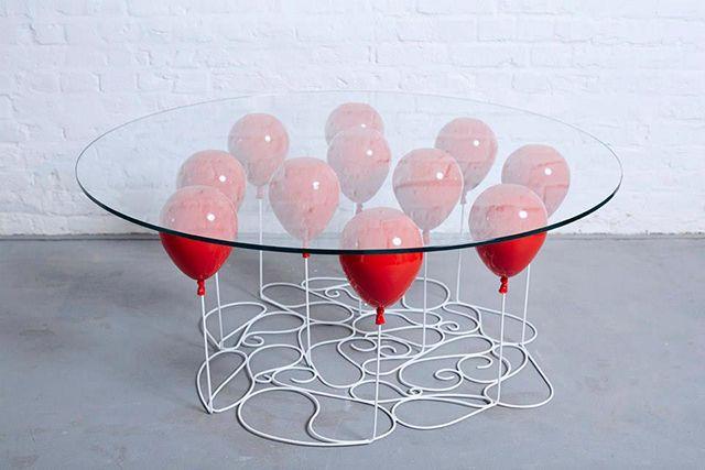 Британская студия Duffy London выпустила стеклянные столы на ножках из железных…