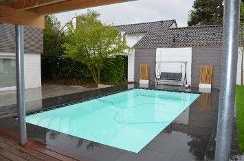 Zwembad gebouwd door Van den Heuvel zwembaden. Basalt hardstenen rand, bodemreinigers maken het bad schoon