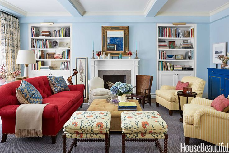 The walls are painted a subtle shade of blue, Benjamin Moore's Lookout Point, in a New York living room designed by Christopher Maya. - HouseBeautiful.com