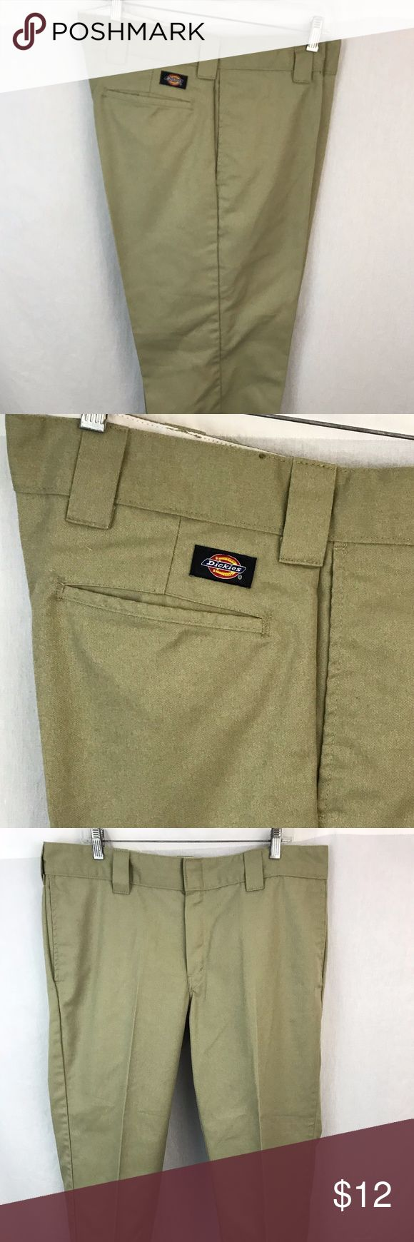 """Dickies Slim Straight Men's Tan Chinos Khakis Excellent pair of men's Dickies Slim Straight Chinos Khakis Work Pants  65% polyester/35% Cotton.  Flat front.   Great pre-owned condition.    Waist is 19.5"""" laying flat.  Inseam measures 30.""""  Leg opening = 8.5"""".  Thanks for looking and please feel free to ask questions. Dickies Pants Chinos & Khakis"""