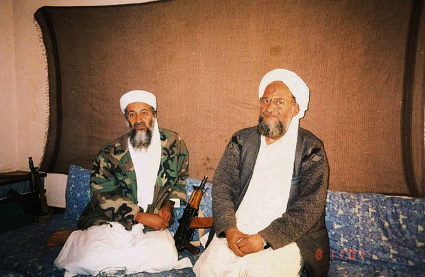 November 10, 2001: Osama bin Laden sits with his adviser Ayman al-Zawahri, during an interview with Pakistani journalist Hamid Mir in an image supplied by the Dawn newspaper