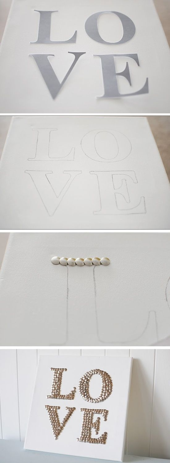DIY 'LOVE' sign made with tacks. This would be great at a party as part of your Valentine's decor.