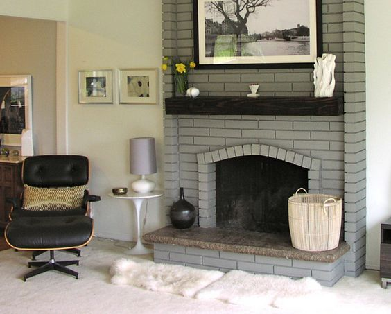 Painted Brick Fireplace In A Light Gray With Dark Wood