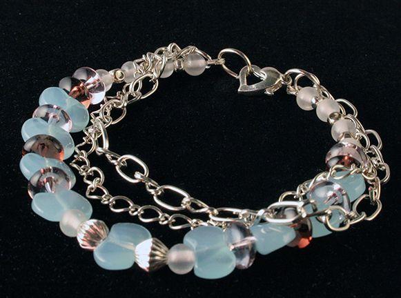 Silver plated, beaded bracelet.