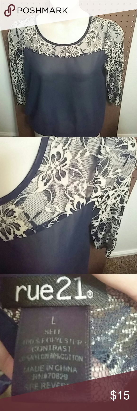 Sheer Navy shell top with cream color lace. 3/4 sleeve, elastic waist with a cut out in the back (last photo).  Really girly!  Dress it up or just a casual night out.  You will need a shirt to wear under it. Rue 21 Tops Blouses