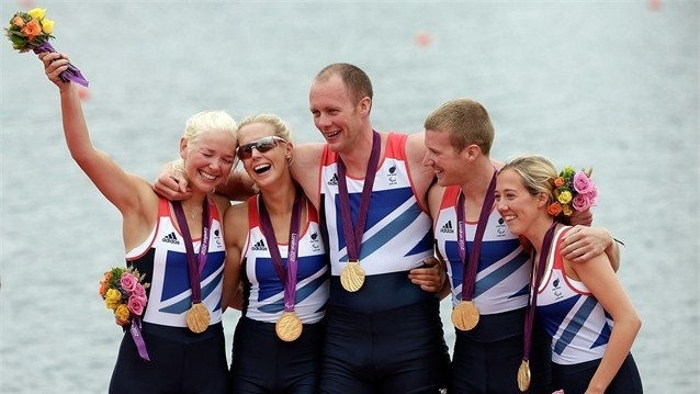 Pamela Relph, Naomi Riches, David Smith, James Roe and Lily van den Broecke of Great Britain's Mixed Coxed Four Rowing team celebrate after winning gold on Day 4